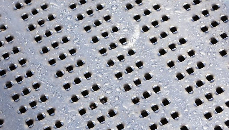 Close-up of a perforated aluminum surface.