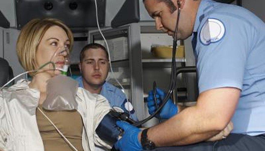 Paramedic assisting patient