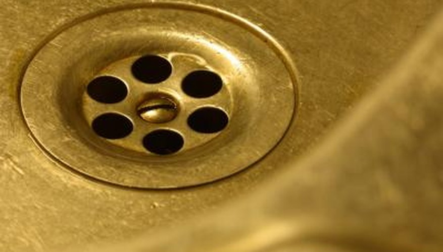 Clear a clogged sink drain with a homemade cleaning solution.