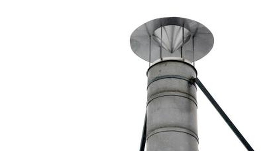 "A metal chimney cowl with a ""hat."""