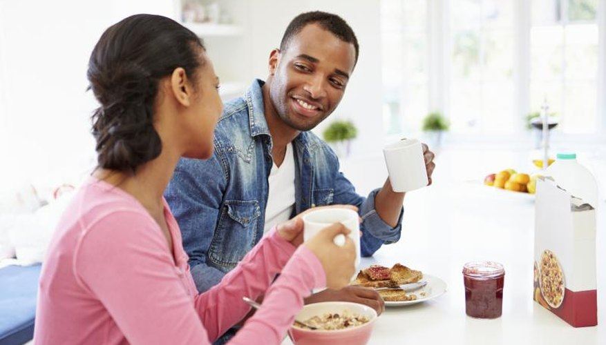 Couple talking at breakfast table