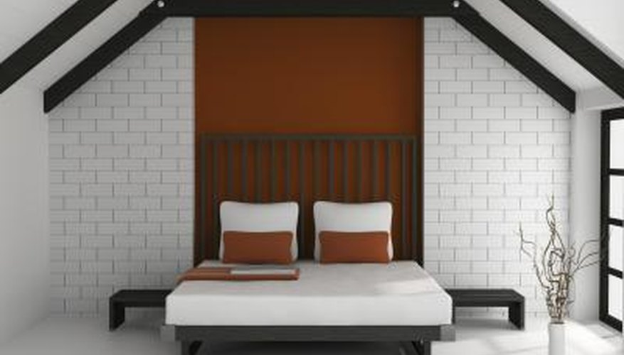 Create a one-of-a-kind bed by painting a new headboard to match the existing base.
