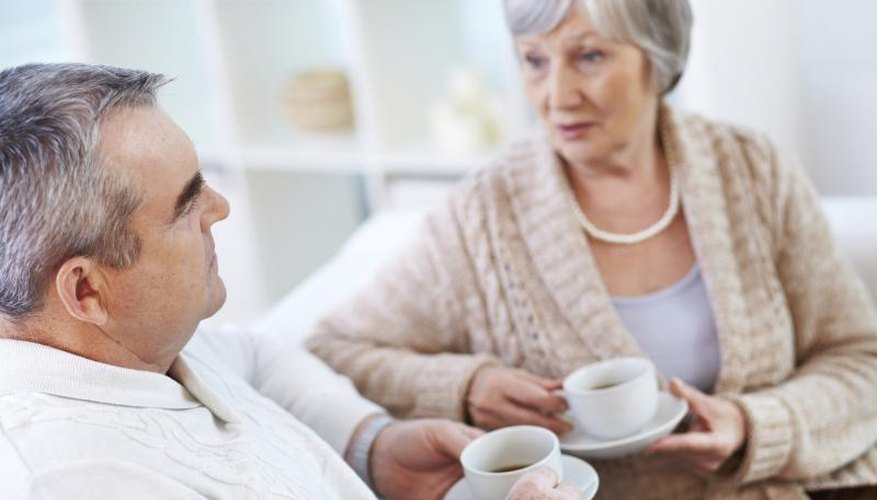 Couple having serious talk over tea