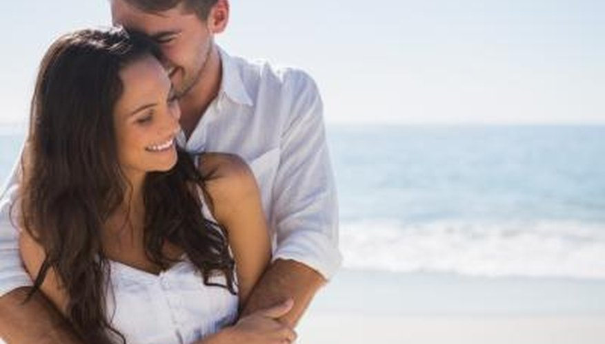 Happy young couple hugging on beach