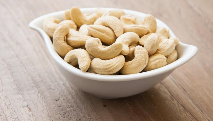 A bowl of whole cashew nuts.