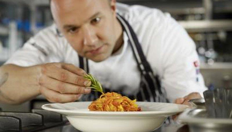 Chef add garnish to entrée
