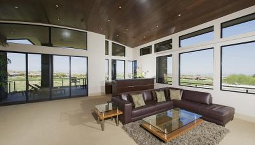 Glass -topped end tables beside brown leather couch