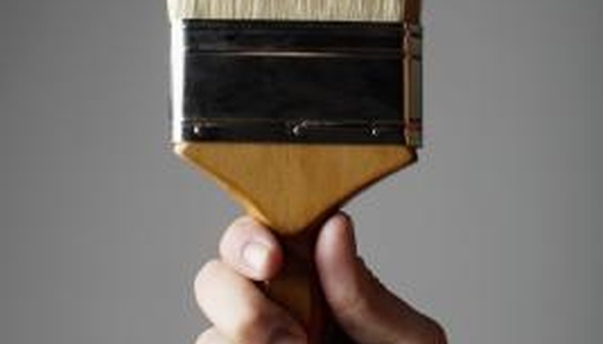 Use a stiff-bristle paintbrush to apply creosote.