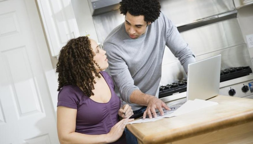 A couple is stressed out paying bills.