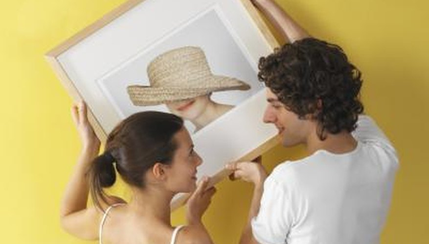 Hang a grouping of pictures accurately and with ease.