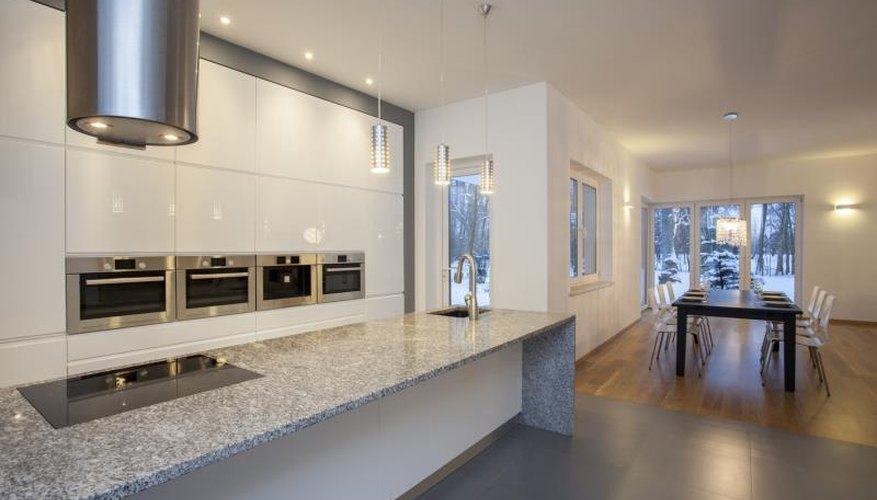 A modern kitchen featuring a granite countertop.