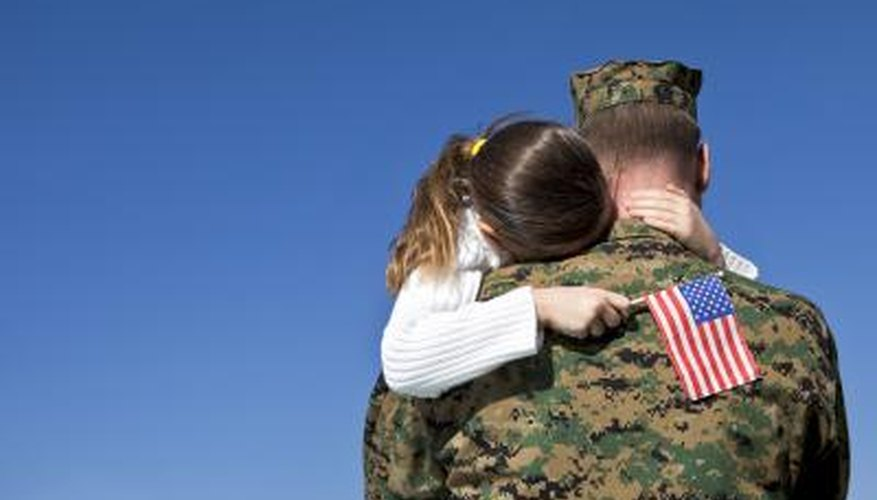 Young child hugging veteran father