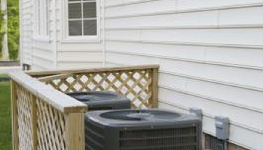 Air conditioning condenser units are located outside the home.