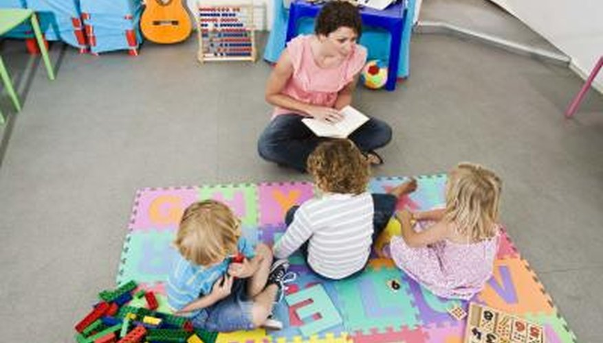 Children on mat listen to care giver