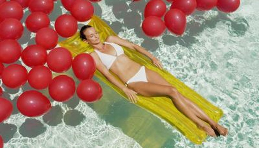 Inflatable water toys make for an inexpensive inflatable bed option.
