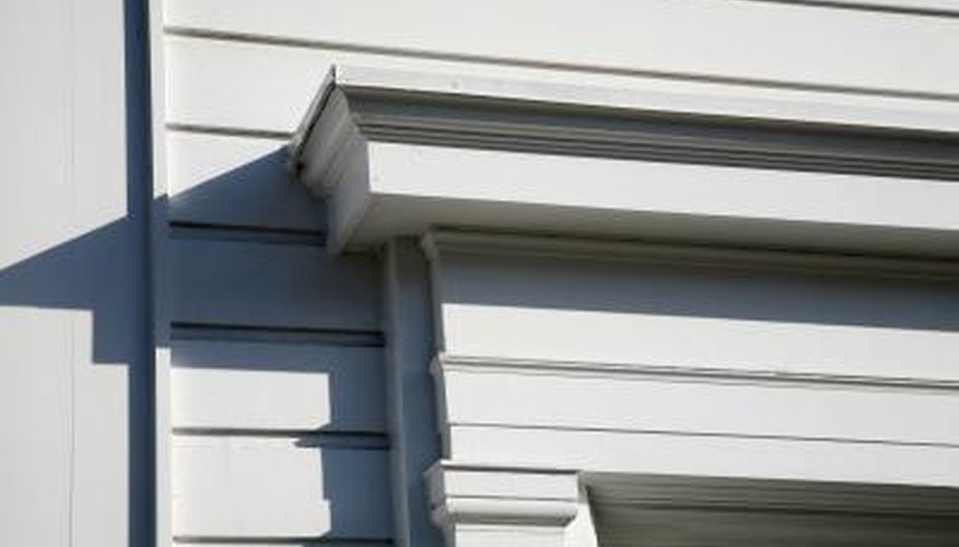 Prime the siding before painting it to create a moisture-resistant surface.