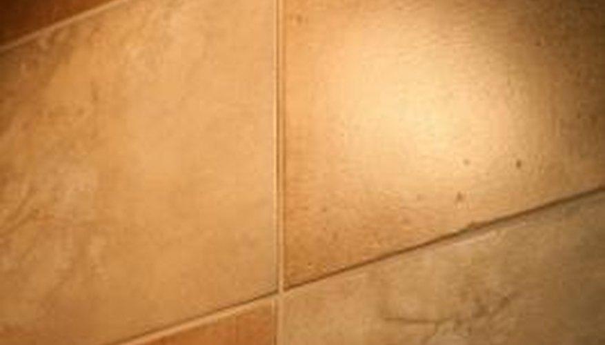 Carpet adhesive resists a good tile bond.