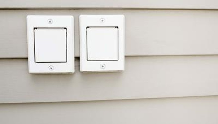 Secure the electrical box to the plywood under your siding.