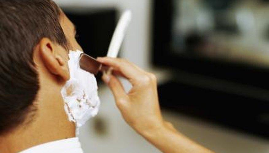 Barber shaving a man.