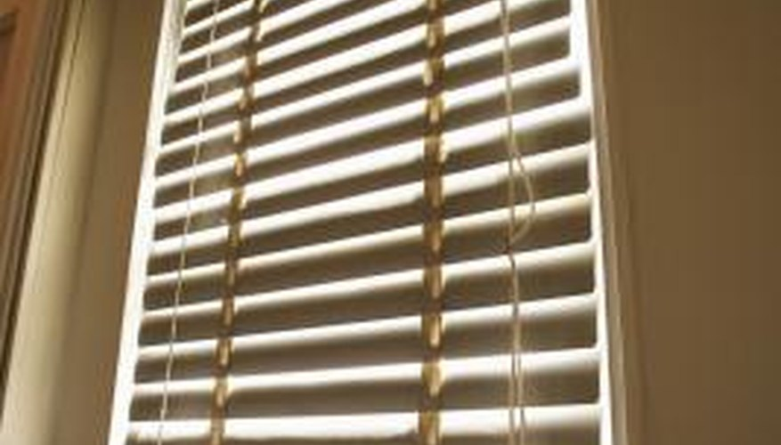 A chemical reaction between sunlight and vinyl causes mini blinds to turn yellowish.