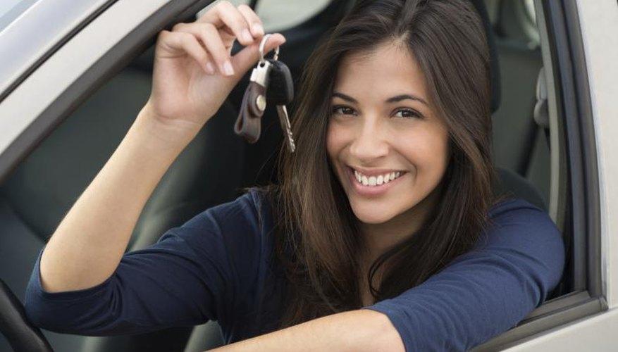 Woman in car holding keys.