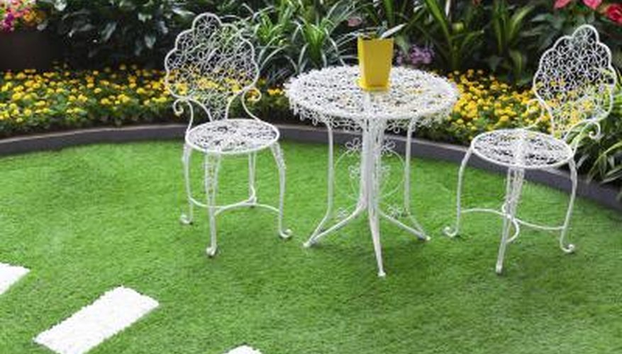 Surround a small table and chairs with carefully selected plantings to create an inviting outdoor retreat.