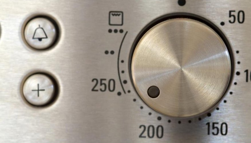 Stainless steel oven temperature dial.