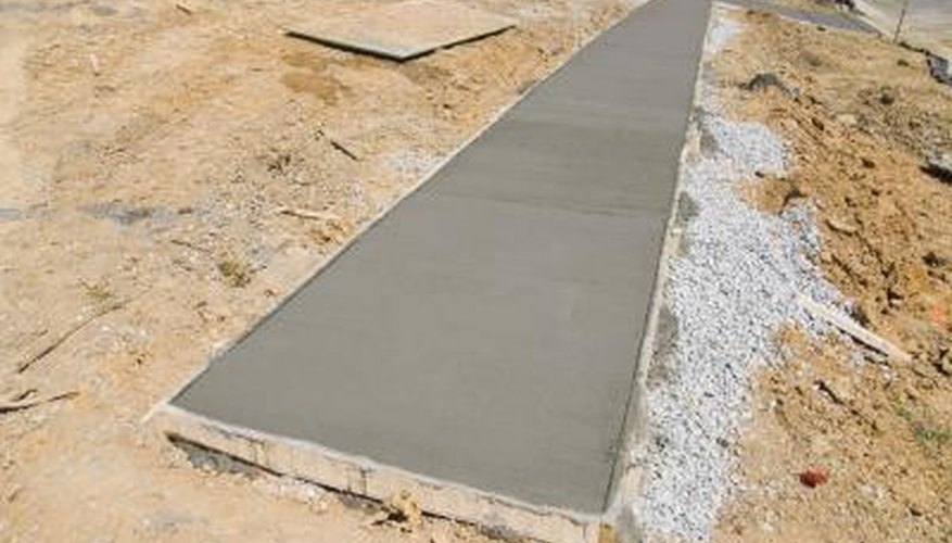A wood frame holds the shape of poured cement while it hardens.