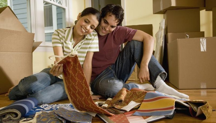 A young couple is looking through textile samples.