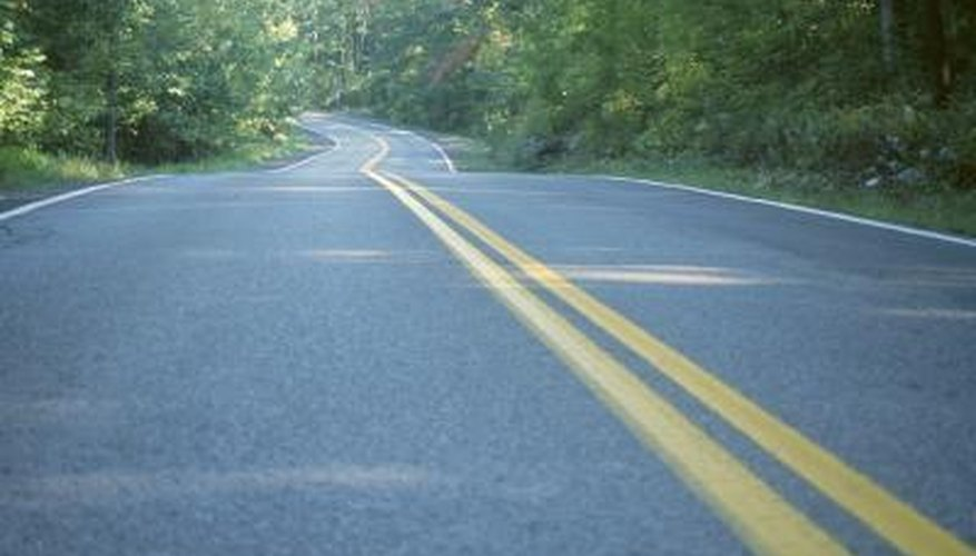 Roll asphalt properly for a smooth surface.