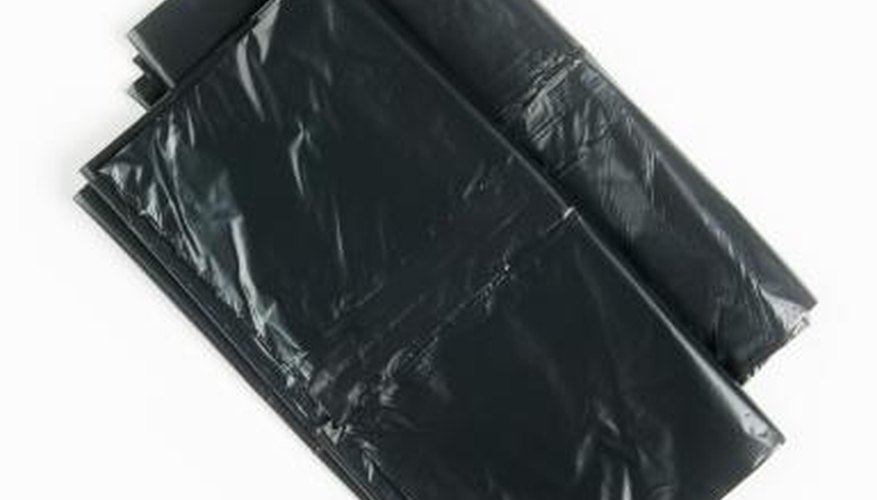 Black trash bags to cover seeds with.