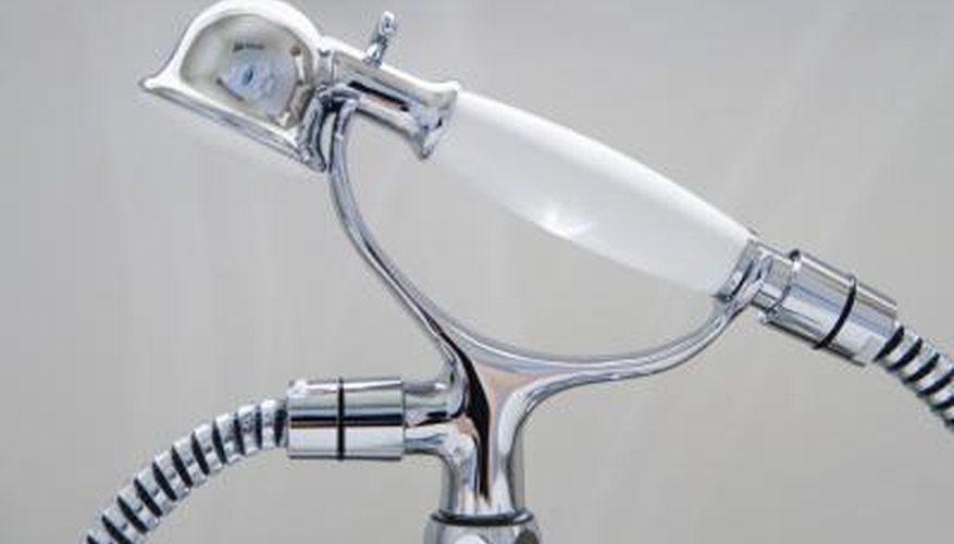 Attaching a hand-held shower to your tub spout is simple and rewarding.