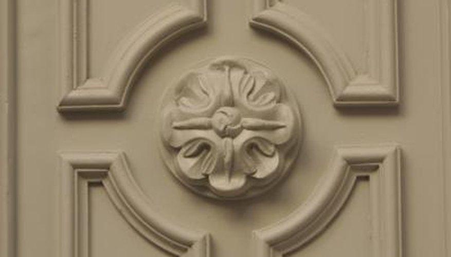 Apply ready-made moldings to dress up plain doors.