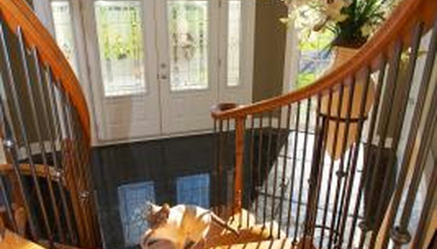 Use varnish instead of paint on a staircase to keep intact the natural beauty of the wood.