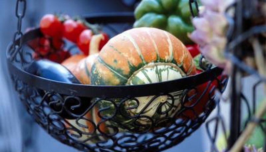 Add chain to an old wire basket to make a chic hanging holder for fruits or flowers.