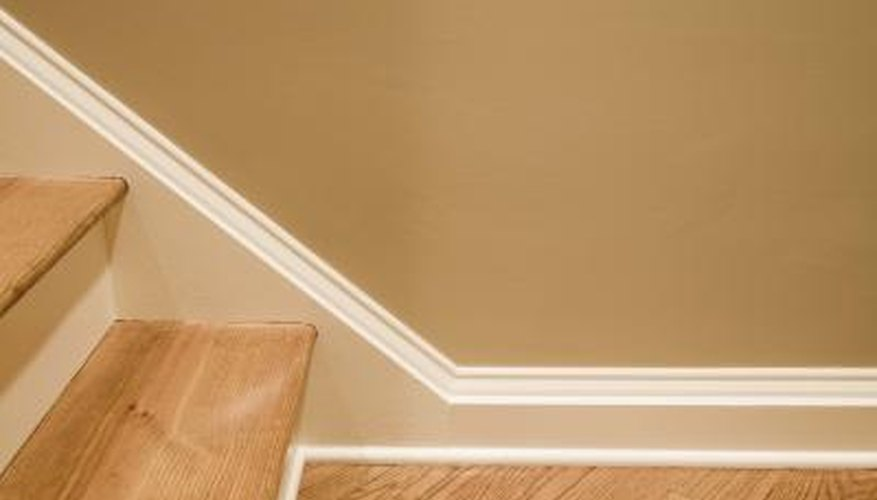 Install quarter round laminate edge trim at the bottom of your baseboards.