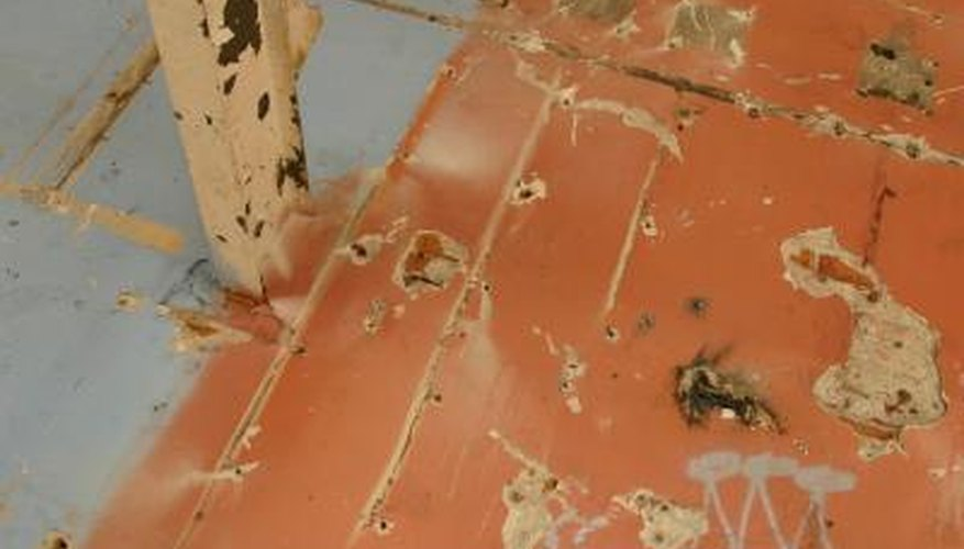 After pulling off the flooring, a buffer makes adhesive removal easier.