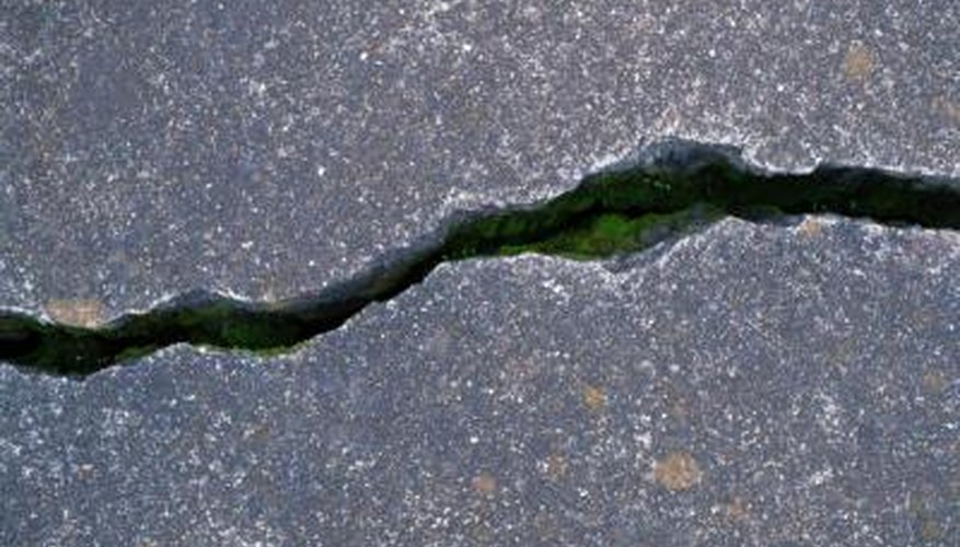 Cracked or damaged concrete is refinished with epoxy plaster and quick cure concrete.