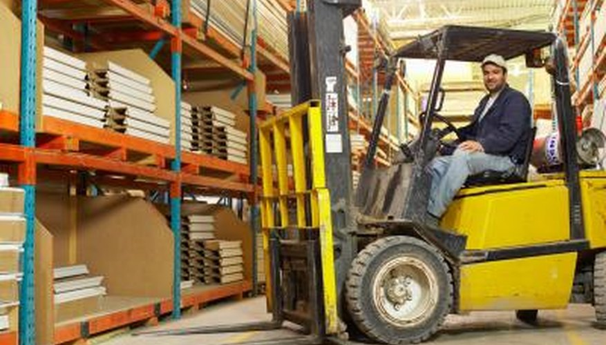 The mast of a forklift is located on the front by the forks.