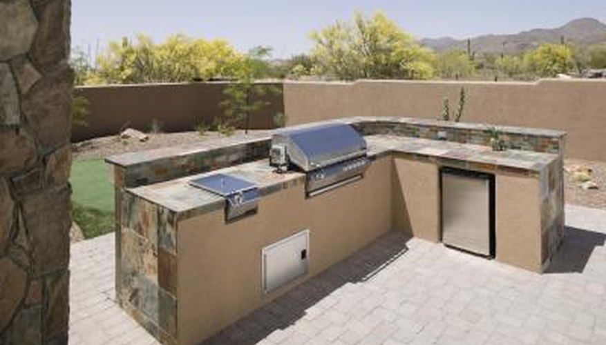 An outdoor kitchen adds convenience to outdoor spaces.