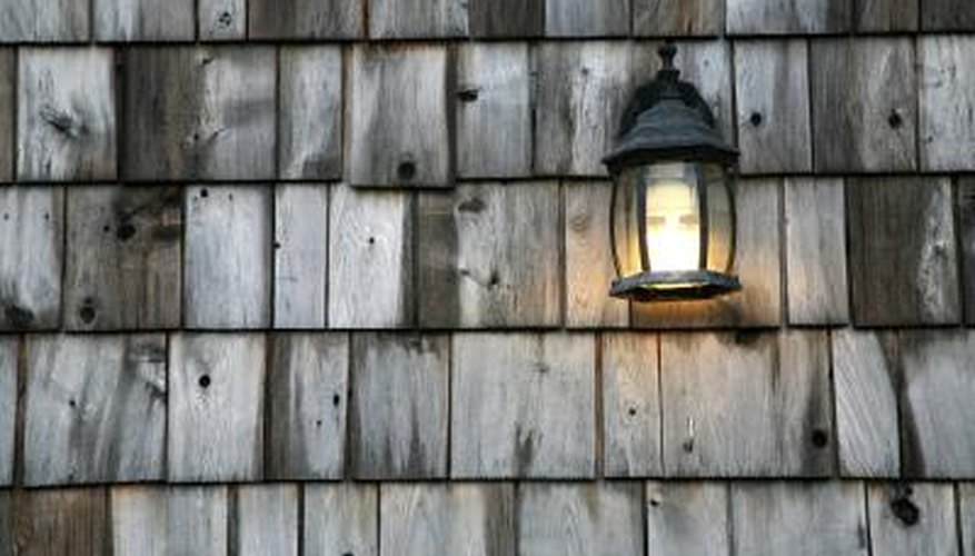 Replace any damaged shingles before covering the old wall.