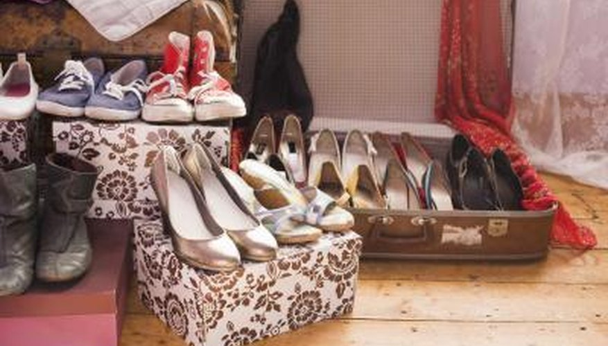 Make way for decorative boxes and vintage luggage to help organize an oddly shaped closet.