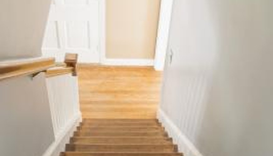 Create a catwalk with a ladder and board to safely paint a stairwell.