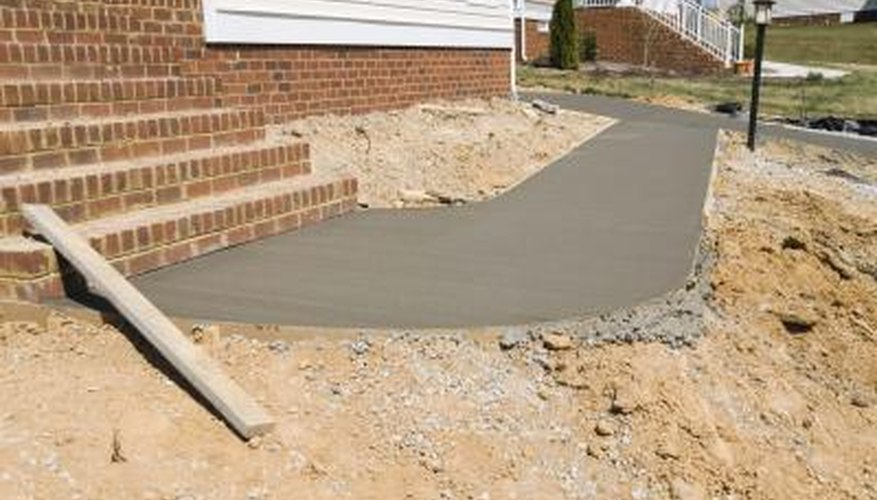 Concrete finishing is done by hand by a skilled laborer.