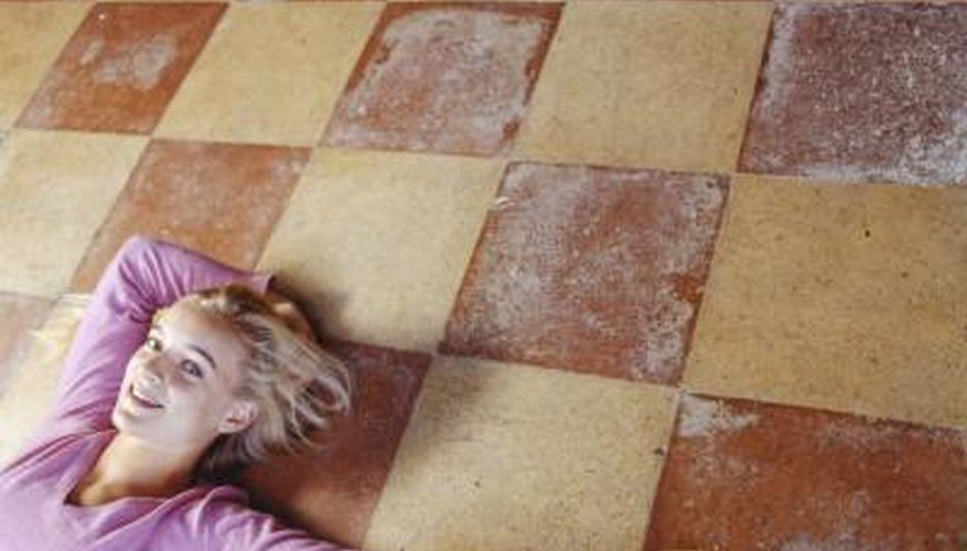One method of adding a pattern is to faux-paint it to look like real floor tiles.