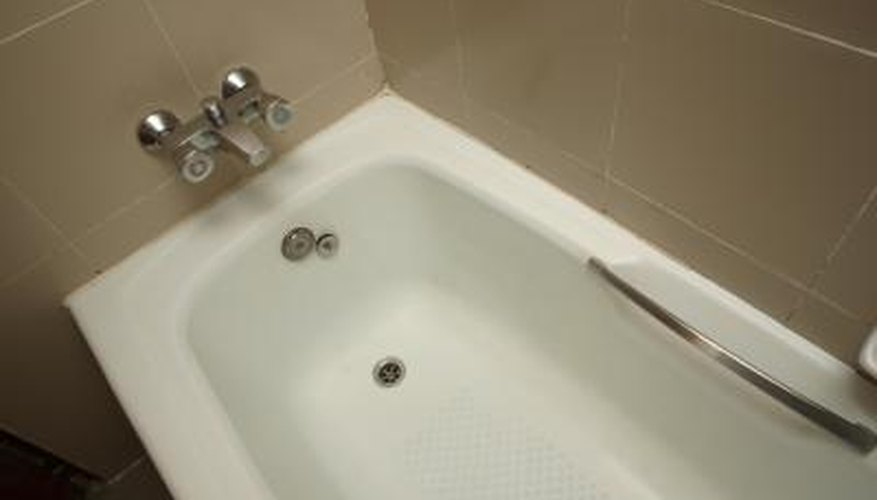Spraying foam can temporarily fix a squeaking acrylic tub.