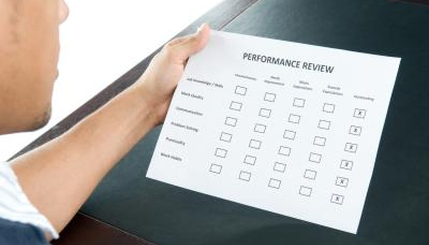 An employee reviewing an excellent performance review