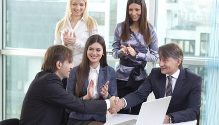 Employee being congratulated for a job well done