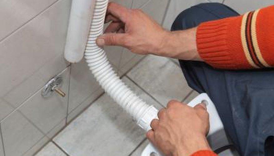 Plumber installing toilet