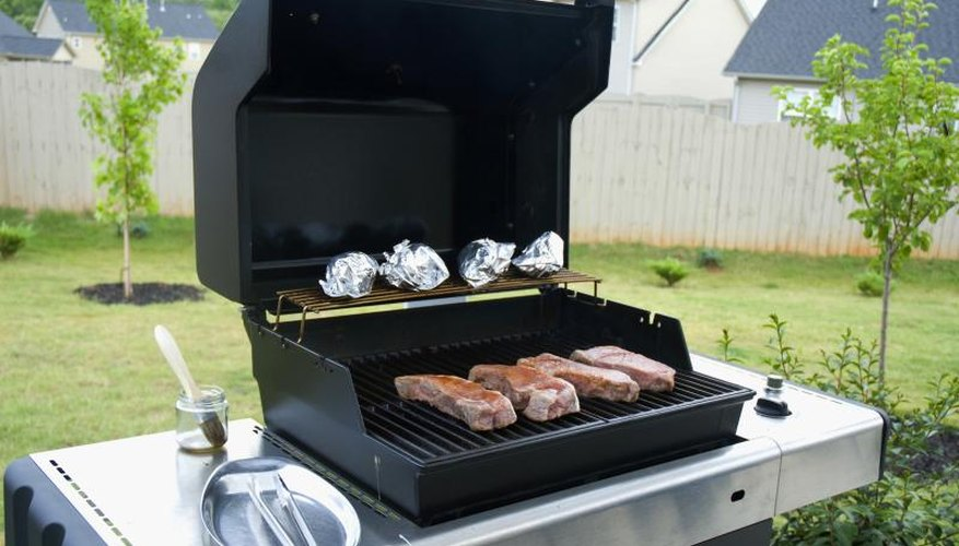 Gas grill with food.